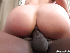 Black man fucks cute young blonde and cums in her ass